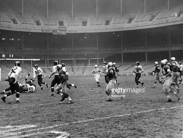 View of a football game between the New York Yankees and the Baltimore Colts at Yankee Stadium New York City October 30 1949