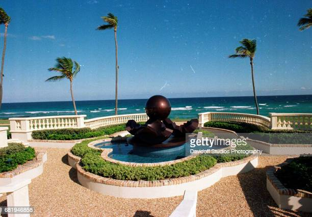View of a fountain sculpture on an oceanfront patio on the grounds of the Maison de l'Amitie estate Palm Beach Florida January 30 1990 The mansion...