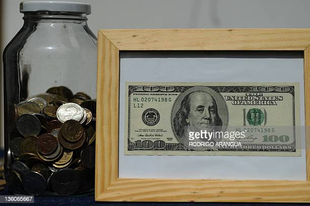 view of a framed one hundred dollar bill next to coins on december 18 2011 in - Dollar Bill Frame