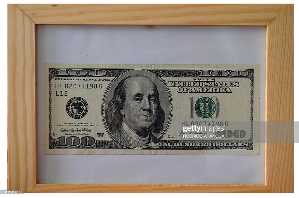 View of a framed one hundred dollar bill Pictures | Getty Images
