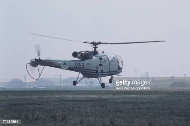 View of a French built Aerospatiale Alouette III helicopter hovering above Le Bourget Airport during a display at the 1971 Paris Air Show in Paris...