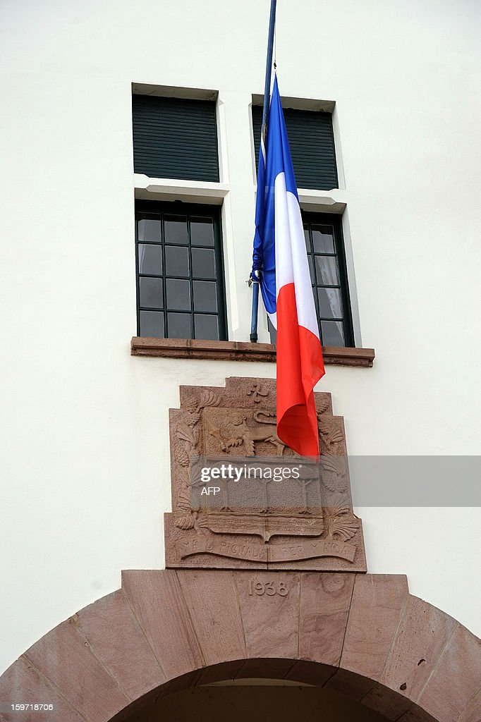 A view of a French flag flying half-mast at the town hall in Anglet, in the French Pyrenees-Atlantiques region, on January 19, 2013, in honor of a French man who was killed in the hostage rescue operation at a remote gas plant seized by Islamist militants in Algeria. Yann Desjeux, 52, who was a former member of the French special forces at the 1st RPIMA in Bayonne, in southwestern France, owned a restaurant, in Anglet.