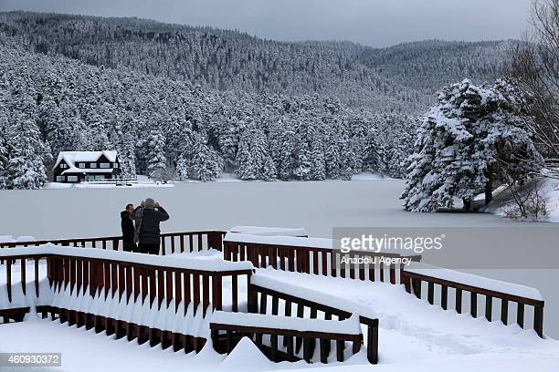 A view of a frozen lake and lake house at the Golcuk Natural Park in Bolu city of Turkey during the winter season on December 31 2014