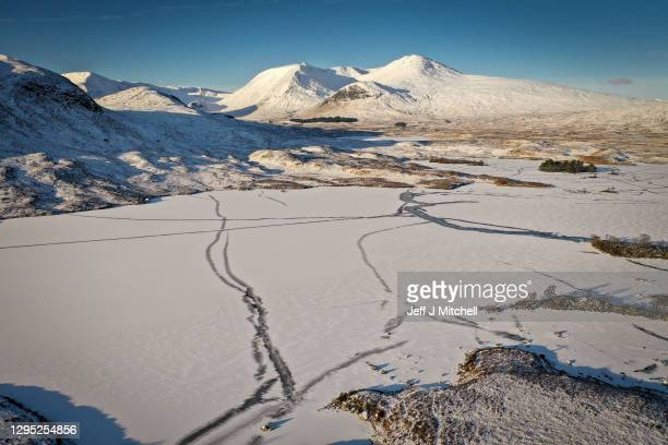 View of a frozen over Lochan na Achlaise as freezing temperatures continue on January 8, 2021 in Glen Coe, Scotland. The Met Office has issued yellow...
