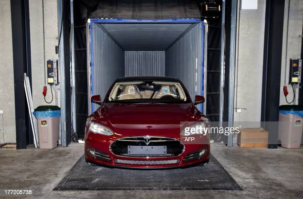 View of a fully electric Tesla car being assembled at the new Tesla Motors car factory in Tilburg, the Netherlands, during the opening and launch of...