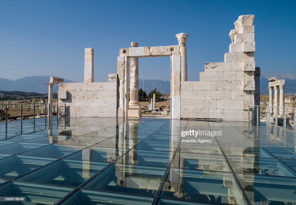 A view of a gate at Laodicea Ancient City in 6 kilometers north of Turkey's Denizli on July 19, 2018. Ancient city was constructed by Antiochus II Theos of Seleucid Empire for his wife during the Helenistic period in mid 3 B.C. City includes Christianity's one of first seven churches. City became a religious center as it reach a level of metropolis in the early Byzantine period. Laodicea's significant structures follow 285 meter long and 70 meter wide Anatolia's biggest stadium, two theatres, four bathhouse complexes, five agoras, five nymphaeums, two monumental entrance gates, Bouleuterion temples, peristyle houses, latrina, churches and monumental streets.