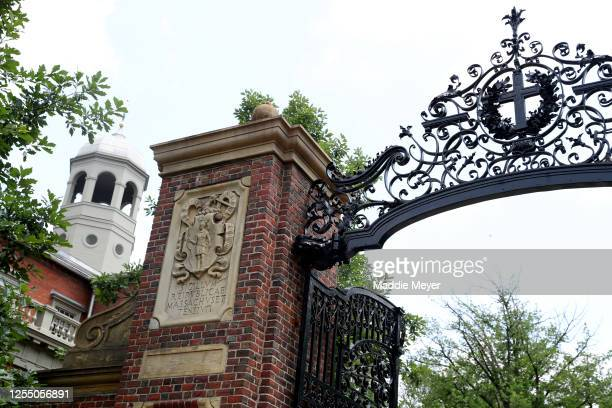 View of a gate to Harvard Yard on the campus of Harvard University on July 08, 2020 in Cambridge, Massachusetts. Harvard and Massachusetts Institute...