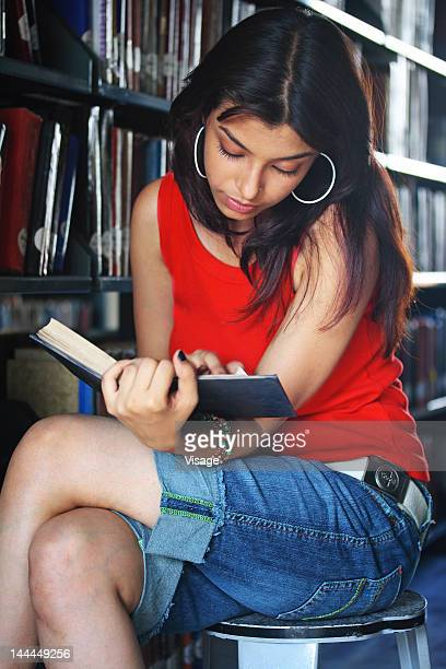 View of a girl in the library reading book