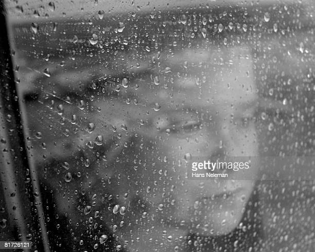 View of a girl through wet glass