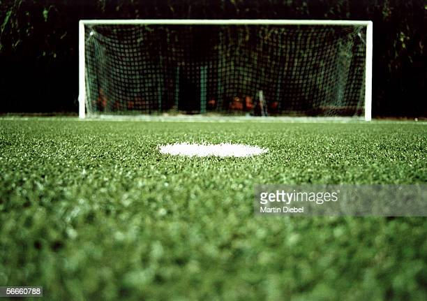 View of a goalpost on a soccer field at night