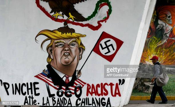 View of a graffiti painted against US President Donald Trump in Mexico City on June 27 2017 / AFP PHOTO / ALFREDO ESTRELLA