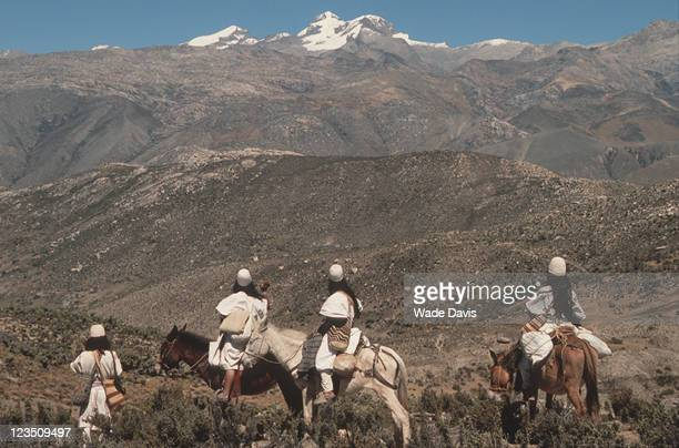 View of a group of Arhuaco people as they pause to look at the scenery of their ancestral land in the Sierra Nevada de Santa Marta mountain range...