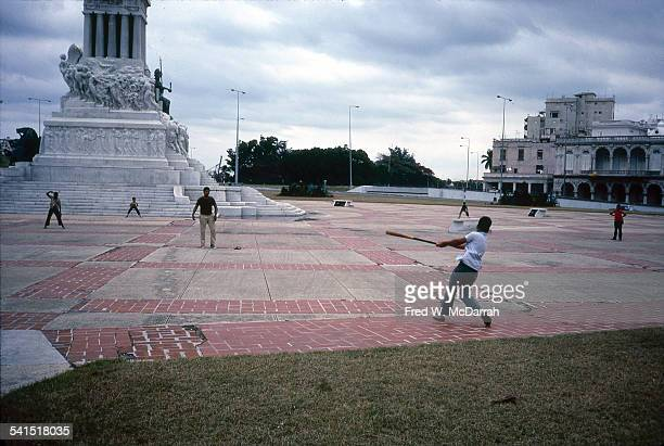 View of a group of boys as they play baseball on the plaza near the Monument To Maximo Gomez Havana Cuba January 29 1983