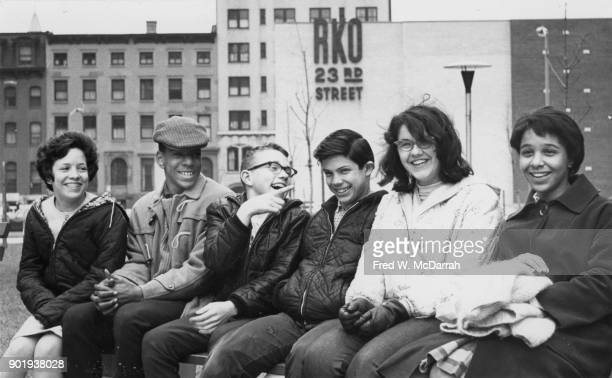 View of a group of children as they clown about on a bench New York New York March 6 1964 The bench is on the grounds of the apartment buildings at...