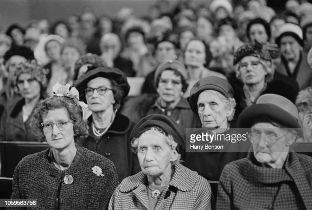 View of a group of elderly women seated in the audience to hear a speech by Conservative Party politician Selwyn Lloyd at a Primrose League meeting...
