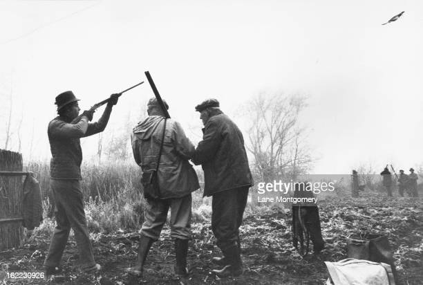 View of a group of hunters taking aim while on a pheasant shoot in Czechoslovakia 1995