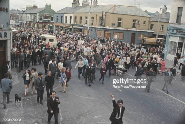 View of a group of local women and residents taking part in a protest march along the predominantly Catholic Falls Road area of Belfast Northern...