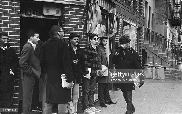View of a group of male highschool students in front of a convenience store on the north west corner of 115th Street and Pleasant Avenue Harlem New...