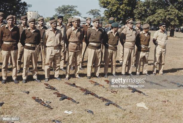 View of a group of Pakistan Army officers standing after laying down their arms at a disarmament ceremony in Dhaka East Pakistan on 19th December...