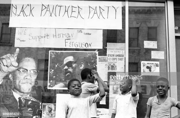 View of a group of unidentified boys as they stand in front of a window display at the Brooklyn Black Panther Party office , Brooklyn, New York, New...