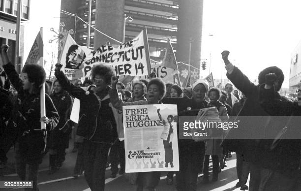 View of a group of women many of whom carry signs and banners with as they march along Church Street during the 'Free Bobby Free Ericka'...