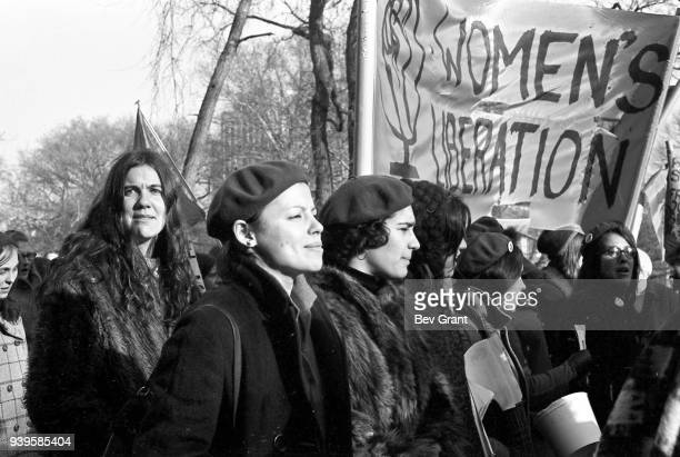 View of a group of women several of whom carry a 'Women's Liberation' banner with as they march during the 'Free Bobby Free Ericka' demonstration...