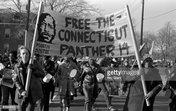 View of a group of women two of whom carry a 'Free the Connecticut Panther 14' banner with as they march during the 'Free Bobby Free Ericka'...