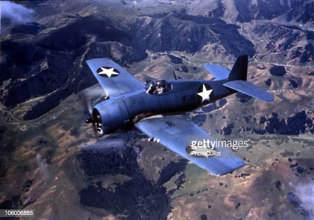 View of a Grumman F6F Hellcat in flight ca 1940s