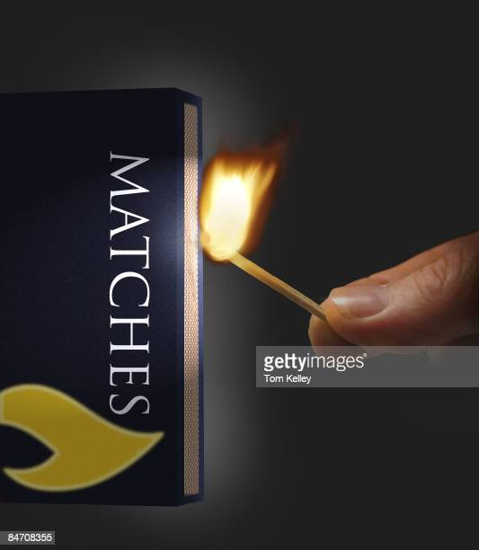 View of a hand striking a match to light a fire 2003 United States