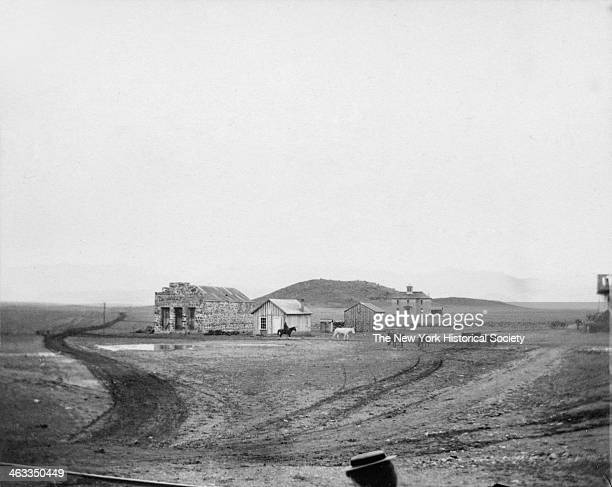 View of a handful of buildings in a small frontier town on the Plains during America's westward expansion era nineteenth century