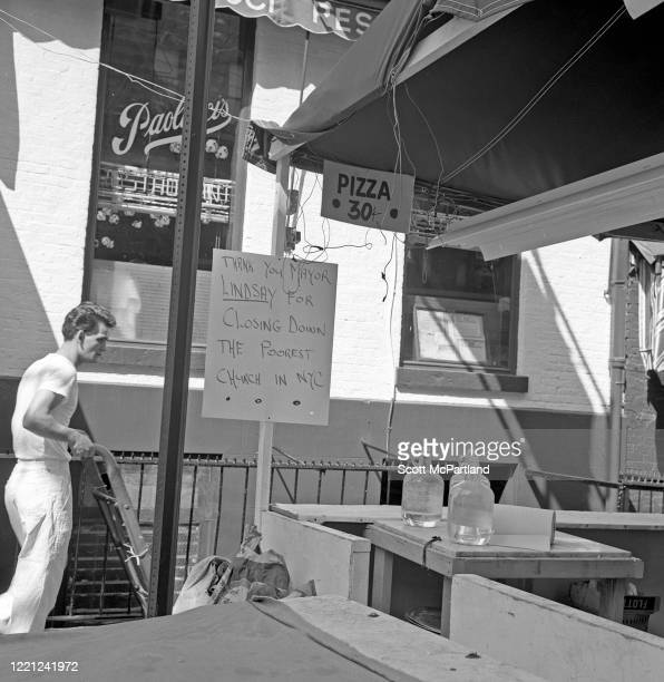 View of a hand-written sign taped to a vendor stall on Mulberry Street during the Feast Of San Gennaro Festival, New York, New York, September 1968....