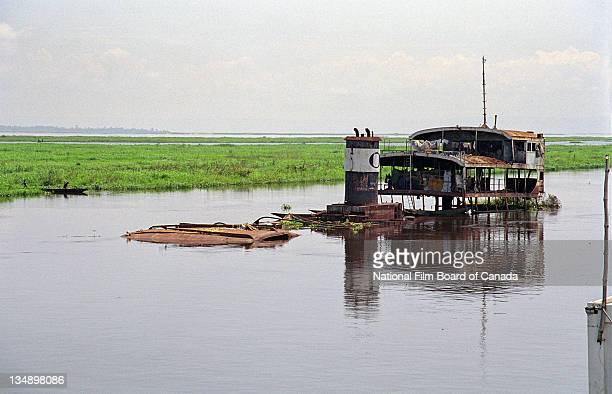 View of a home built onto a sunken and rusted boat on the Congo River near Kinshasa Democratic Republic of the Congo 2003 Photo taken during the...
