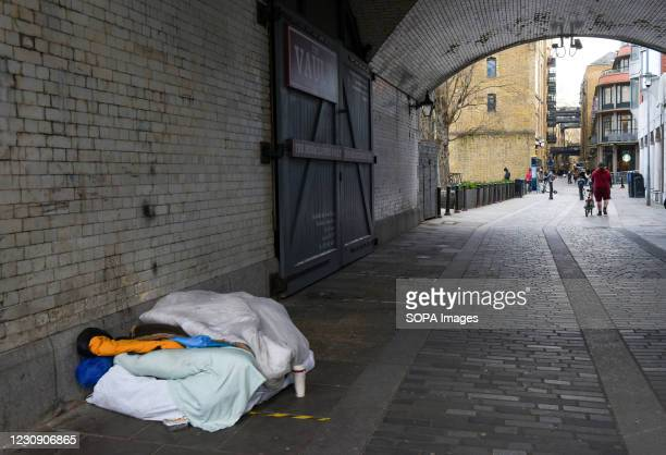 View of a homeless man's bed under the Tower Bridge. Government urges people to stay at home and only go out if they have a reasonable excuse. UK is...