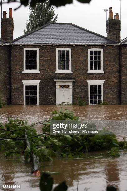 View of a house surrounded by water in Beverley North East Yorkshire after heavy rainfall caused flooding