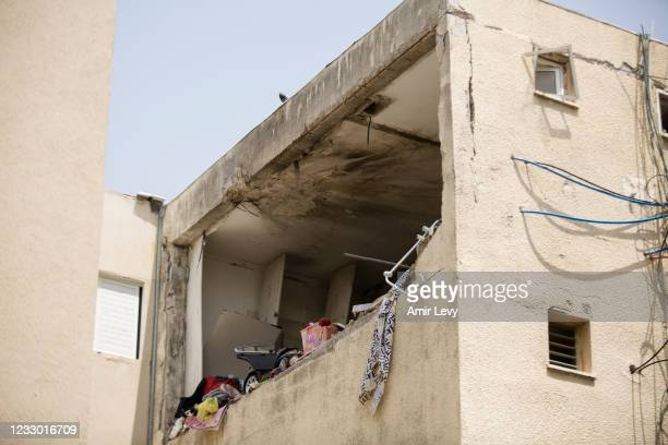 View of a house that was hit by a rocket fired from the Gaza Strip earlier this week on May 21, 2021 in Zikim, Israel. Yesterday, Israel's cabinet...