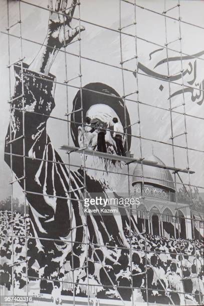 View of a huge mural of Ayatollah Khomeini in making as he waves next the Dome of the Rock in Jerusalem, while artists are seen up on scaffoldings in...