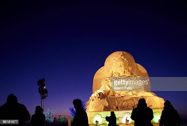 A view of a huge snow Buddha during the 26th Harbin International Ice and Snow Sculpture Festival on January 24 2010 in Harbin China The sculptures...
