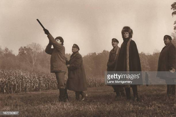 View of a hunting party out for pheasants with one man taking aim as others watch Czechoslovakia 1995