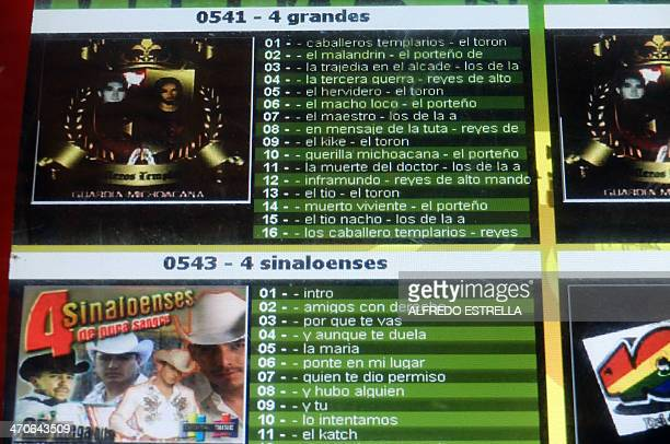 View of a jukebox displaying CDs with music by drug cartel Knight Templar on a restaurant at the Buenavista community Michoacan state Mexico on...