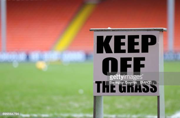 A view of a Keep Off the Grass sign at Bloomfield Road