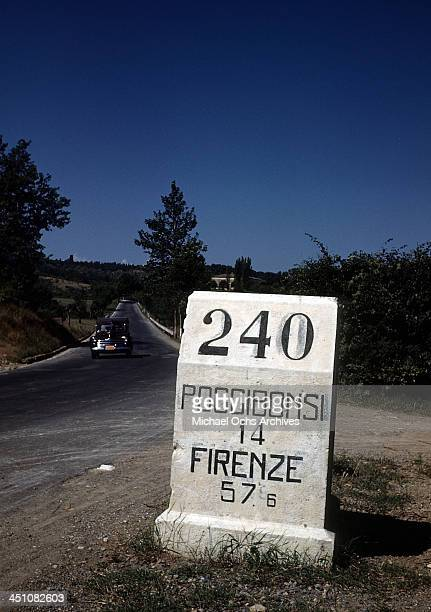View of a Kilometers marker sign showing how far Poggibonsi and Florence are in Italy.