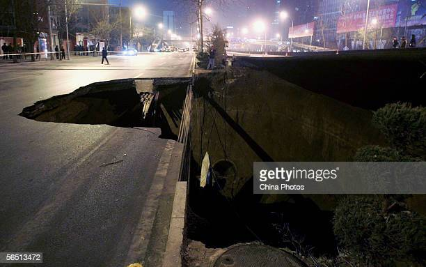 A view of a land cavein site near Jingguangqiao Bridge on the east Third Ring Road on January 3 2006 in Beijing China Sewage leaked from a burst...