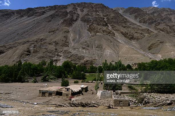 A view of a landslideaffected village following flash floods in the GuzargaheNur district of the Baghlan province of Afghanistan on June 9 2014...