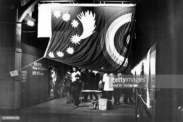 View of a large flag over attendees at the Tenth Avant Garde Festival New York New York December 9 1973