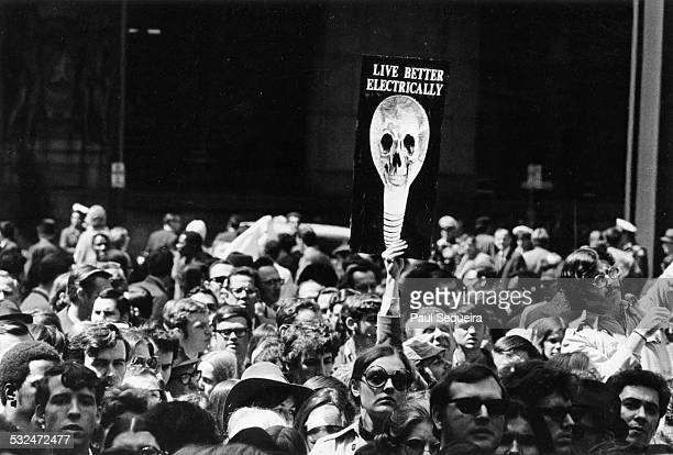 View of a large group of protestors participating at the first Earth Day demonstration at Daley Plaza Chicago Illinois April 22 1970 One holds up a...