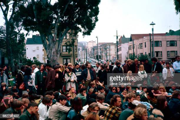 View of a large group of young men and women as they attend an unspecified event in a park in the HaightAshbury neighborhood San Francisco California...