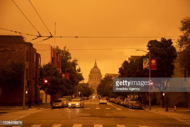 View of a layer of smoke generated by the over 2 dozen wildfires burning in California created and eerie orange glow over mush of the San Francisco...