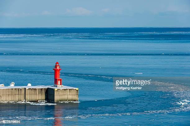 View of a lighthouse at the harbor in Utoro in the Sea of Okhotsk in winter, Abashiri Shiretoko National Park , Shiretoko Peninsula on Hokkaido...
