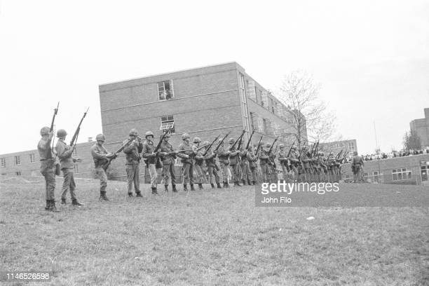 View of a line of armed Ohio National Guardsmen as they stand at the top of Blanket Hill, facing the Commons, on the Kent State University campus,...