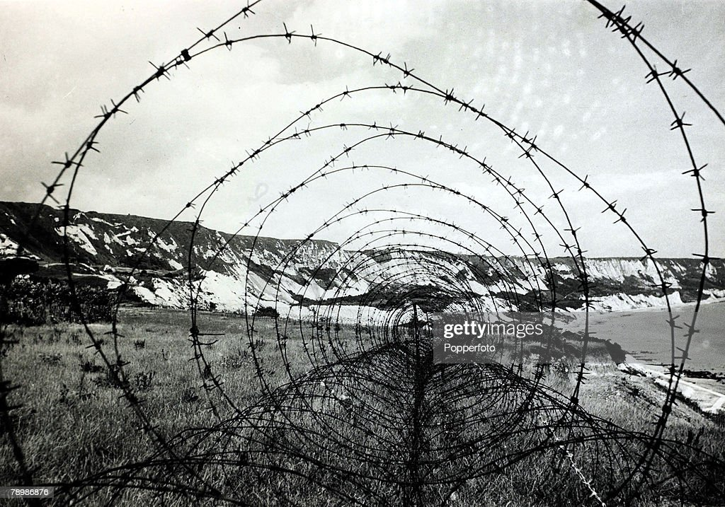 War and Conflict. World War II. pic: 1940. Barbed wire defences on ...